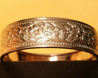 Hinged Reprosse Floral Bracelet. Unsigned. 7.75 inch