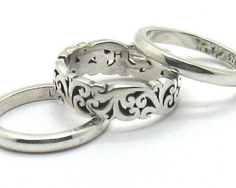 New Lois Hill .925 silver 3 ring set (1) open cutout and (2)  plain silver.  Size 7.
