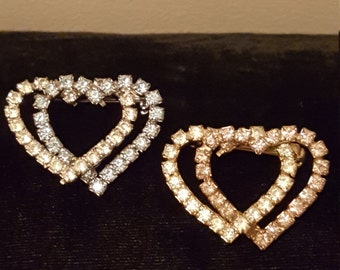 Two vintage rhinestone heart shaped brooches