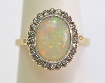 Vintage Opal/Diamond Halo Ring 14kt yellow gold