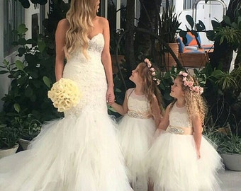 Stunning ivory 'Belle' flower girl dress, ivory sash,lace, tea length poufy tulle skirt,  ivory netting & ivory sash with rhinestone.
