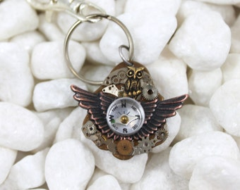 Steampunk keyring with wings, compass, owl and watch parts and gears