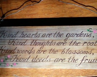 Wooden hand lettered sign.