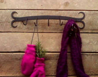 hand forged wall mount rack.