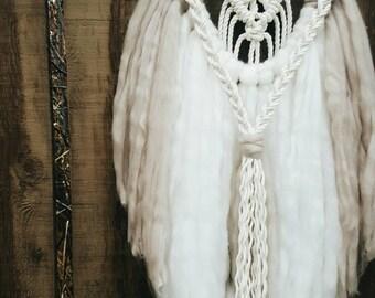 plush vegan boho wall hanging in winter white and cashmere