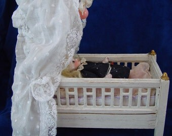 Antique collector's item antique dollhouse dollbed with bedlinen for antique dollhouse