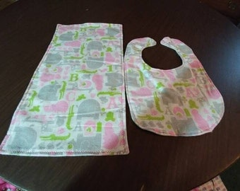 Elephants and hippos bib and burp cloth set.