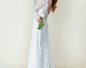 Long sleeve open back wedding dress. A-Line wedding dress. Lace wedding dress with a train. Free Shipping
