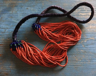 Multi strand tribal necklace with tiny red tube beads and blue velvet