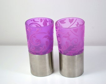 A pair of mid century modern candle holders/ Stainless steel with purple glass/ velvet flower designs.