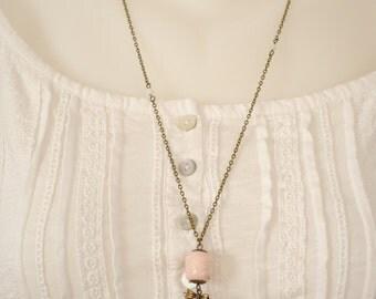 Necklace has photo, ceramic bead.