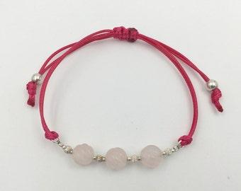 Bracelet in silver and pink quartz carving