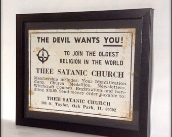 Aged reproduction Satanic Church recruitment advertisment in frame.