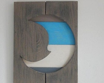 Colored moon on pallets wood