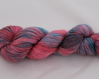 A Luxuriously soft Hand dyed 4ply Yarn on a Super Wash Merino, Tencel base in the Morning Skies colourway. A blend of soft pinks and blues.