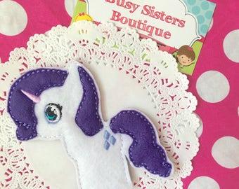 White unicorn finger puppet