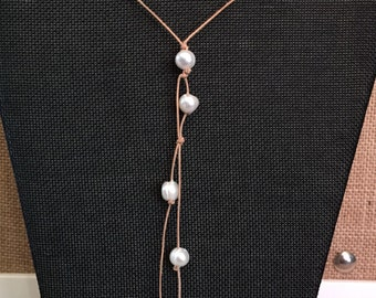 Freshwater pearl necklace, Pearl and cord necklace. Long pearl necklace