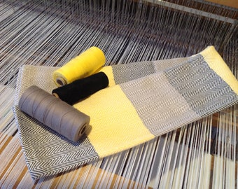 Herringbone pattern black, gray, yellow towel completely hand woven in to Marie Rose