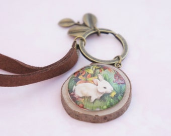 Keychain with white rabbit cabochon on little piece of wood. A really cute charm with a  cabochon. The perfect as a Mori jewelry