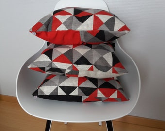 Cushion cover and basket red, black and grey geometric patterns