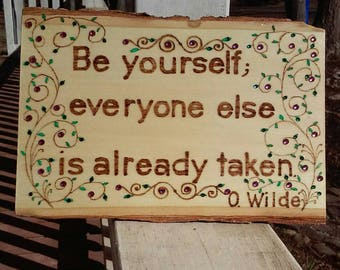 """Wood burned plaque with the inspirational quote """"Be yourself..."""" decorated with leaves and vines, painted and embellished with crystals"""