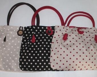 Fabric bag with rigid handle