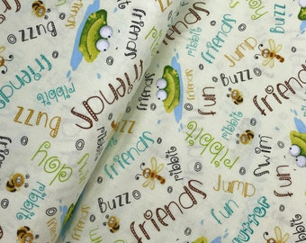 Cream Frogs with Words from the Frogland Friends Collection by Nidhi Wadhwa for Henry Glass Fabrics