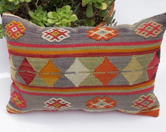 Vintage Turkish Kilim pillow cover in blue, orange, seafoam, pink, yellow and red.