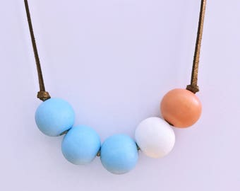 blue, white and salmon hand painted wooden bead necklace