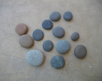 Thirteen smooth , river rocks . Ready for crafting.