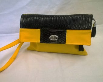 Yellow and black clutch, shoulder or wrist strap.