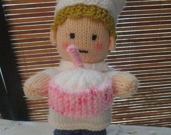 Hand Knitted Chef Doll - Wearing White Chef Suit with Birthday Cake