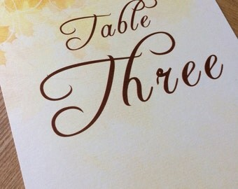 Fall wedding table numbers / names - beautiful Autumn leaves in russet, orange and yellow.