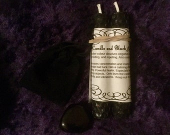 Black pagan beeswax spell candles with black agate meditation stone.