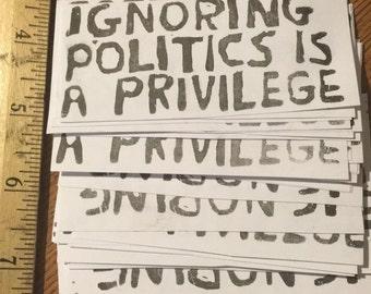 Ignoring Politics is a Priviledge Stickers- 40