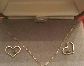 14k gold earrings and floating heart w/emerald