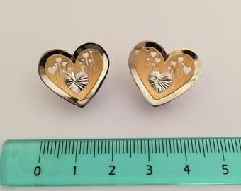 Heart shaped earrings in white and yellow 18k gold.