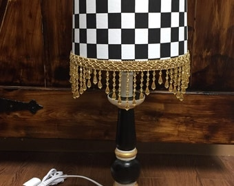 Lamp handpainted in black and white checks gold accents gold bead fringe