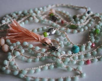 A versatile, long, beaded necklace.