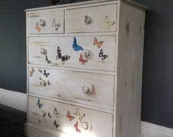 SOLD. Chest of drawers in white and cream with butterfly's, distressed, vintage, bedroom furniture.