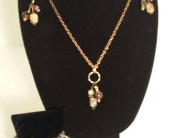 Mixed beads on antique brass chain w earrings.