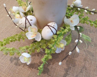 Candle ring with bright lovely orchids, green foliage, cream white pips and 2 cream speckled eggs. Spring sale price!