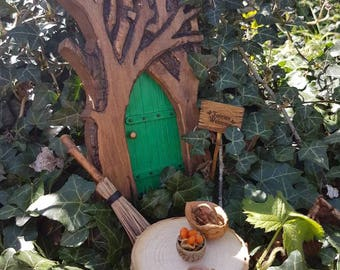 Magical Green Fairy Door complete with Fairies Welcome Sign,  Broom,  Table,   Acorn Bowl,  Acorn Cup and Walnut Basket.