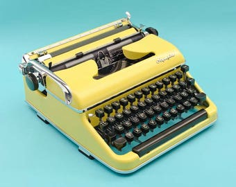 Yellow 50s Olympia typewriter with case