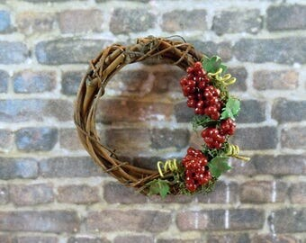 Dollhouse Miniature accessory in twelfth scale or 1:12 scale.  Grape vine wreath with grapes.  Item #327.