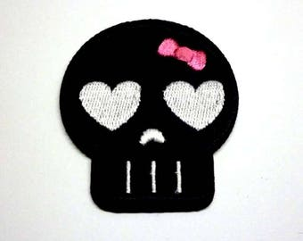 Black Emo Skull with Silver Eyes and a Pink Bow Iron on Patch - H380