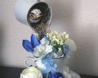 Owl in next floral arrangement using cameo teaset