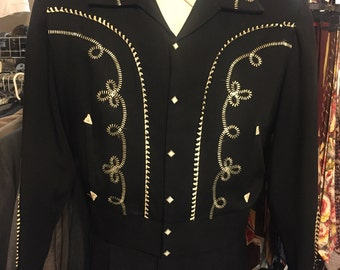 Out of breath: a gabardeen western jacket with white piping and embroiderd detail of the 1950s