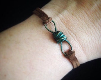 Turquoise Painted Metal Knot on Brown Suede
