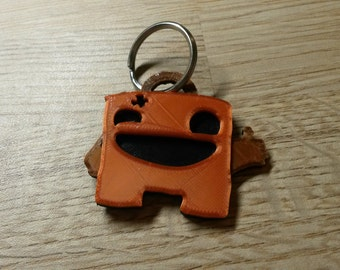3D printed Super Meat Boy keychain